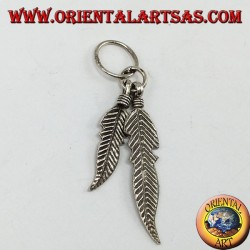 Silver pendant with two Native American style feathers