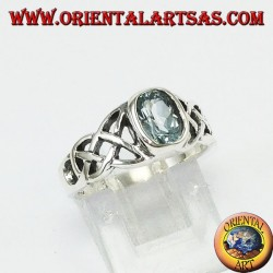 Silver ring, with central blue topaz and tyron knots on the sides