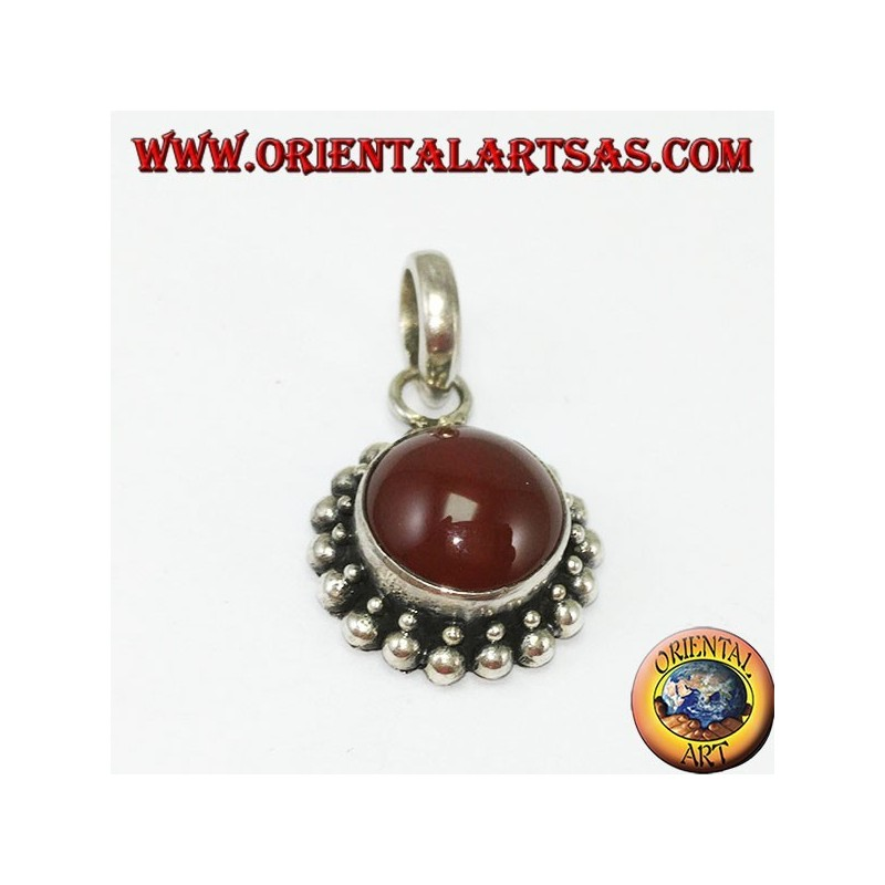 Silver pendant with round carnelian and border with two rounds of spheres