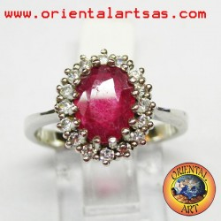 Silver ring with ruby surrounded by zircons