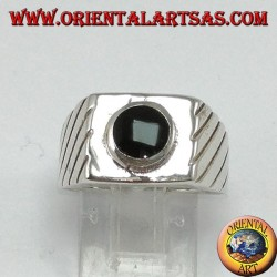 Silver ring with raised round onyx on a square base