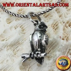 Pendant in silver owl on the three-dimensional branch