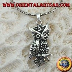 Owl-shaped pendant on the silver branch