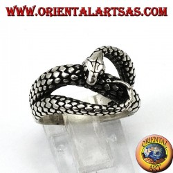 Silver ring in the shape of a cobra snake that bites