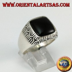 Silver ring with square onyx surrounded by engravings