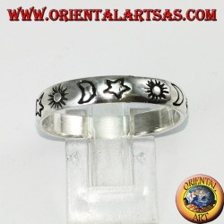 Silver ring engraved with sun and moon