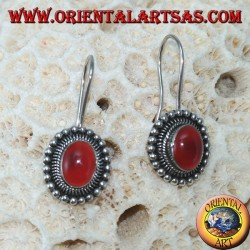 Silver earrings with oval carnelian is surrounded by dots