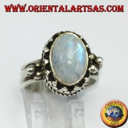 Silver ring with oval rainbow moonstone on high edge