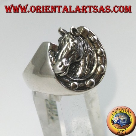 Silver ring depicting a horseshoe and a horse's head
