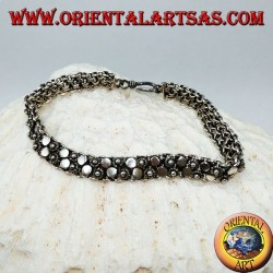 Silver bracelet with two rows of small flowers and round plates