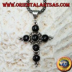 Pendentif croix en argent avec six étoiles noires rondes