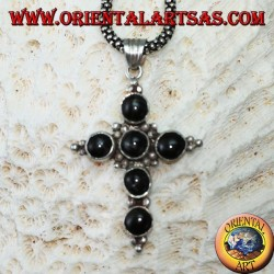 Silver cross pendant with six round black stars