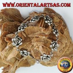 Silver bracelet of big roses