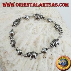 Bracciale di elefanti e cuori alternati in fila in argento