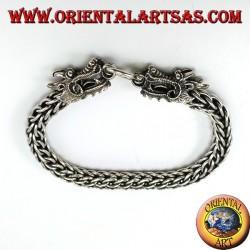 Два серебряных браслета с драконьей головкой