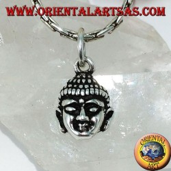 Silver pendant head of a radiant Buddha