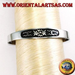 Silver cuff bracelet with central low relief carving
