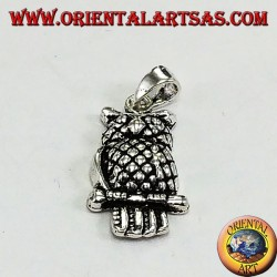 Silver eagle owl pendant on the branch