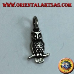 Silver pendant owl on the curved branch