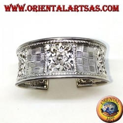 Hand-chiselled wide silver bracelet with square floral motifs