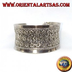 Wide silver bracelet, hand chiselled with small flowers (concave)
