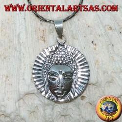 Silver pendant head of a radiant Buddha