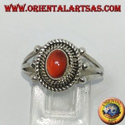 Silver ring with carnelian cabochon surrounded by three serpentine threads