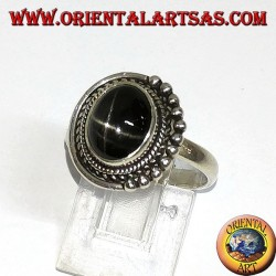Silver ring with black oval set inlaid