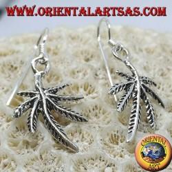 Silver earrings in the shape of marijuana leaf