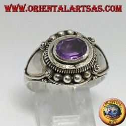 Silver ring with natural oval faceted Amethyst mounted crosswise
