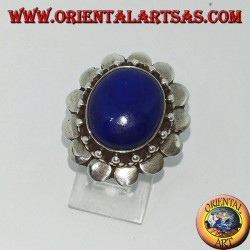 Silver ring with oval lapis lazuli surrounded by round plates