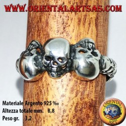 Silver ring with three skulls with bone