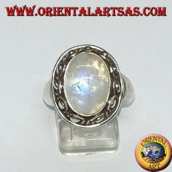 Silver ring with oval rainbow moonstone and set with a studded edge with dots