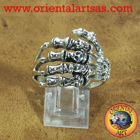 Silver ring, hand with skulls