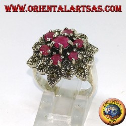 Silver ring in flower with seven rubies set surrounded by marcasites