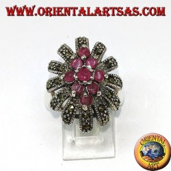 Silver ring, oval high with 9 rubies set surrounded by marcasites