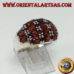Silver ring with a rounded band with 16 oval natural garnets