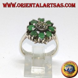 Silver ring in flower with 8 natural round emeralds surrounded by marcasites