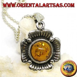 Silver pendant in the shape of a flower with a central hemispherical amber