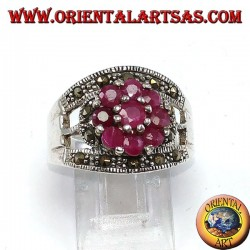 Silver band ring with a flower set with 9 round rubies set
