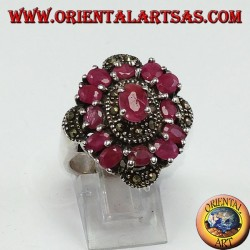 Silver ring with 13 oval rubies set and adorned with marcassite