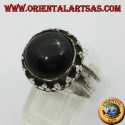 Silver ring on high edge with round Black Star set
