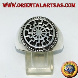 "Silver ring with black sun (""the wheel of the sun"")"