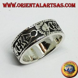 Silver band ring with Maori bas-relief designs