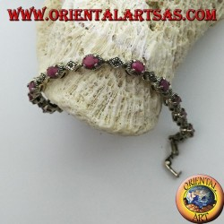 Silver bracelets with 12 oval rubies set with 4 jaws, and marcasite