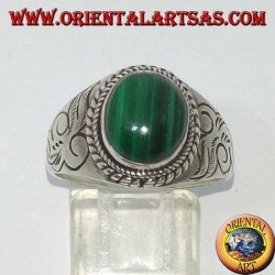 Silver ring with oval malachite and incisions on both sides