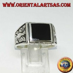 Silver ring with rectangular onyx and bas-relief eagles on both sides