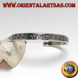 Rigid bracelet in silver, with beating incisions of contrived moons