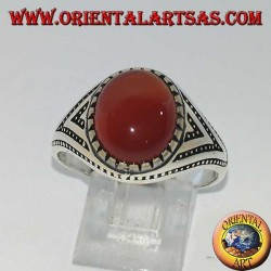 Silver ring with oval carnelian set with triangles and lateral dot decorations