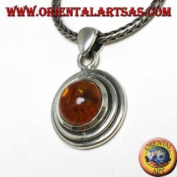Silver pendant with a round amber, and two-wax edge